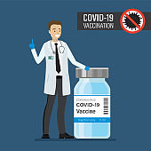 Happy caucasian doctor standing near coronavirus vaccine. Medical staff in white coat and protective gloves. Vaccination against Covid-19