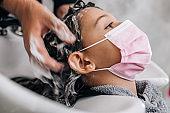 Beautiful girl at hair salon
