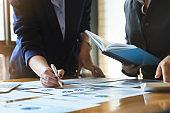 A business advisor explains graphs statistics and ways to increase profits this quarter