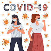 Two girls wearing face medical masks protesting against covid-19, concept of world epidemy