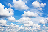White fluffy clouds on clear sunny blue sky background close up, cumulus cloud texture, cloudy azure skies backdrop, beautiful cloudscape view, summer day heaven, cloudiness landscape, overcast, space