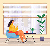 Woman sits at armchair and reads document, office modern room, urban view from the window.