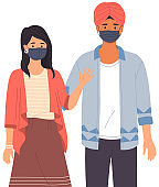 Indian man and girl wearing medical masks. Multinational couple on self-isolation during pandemic