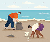 Man and woman cleaning up paper and plastic waste on shore. Volunteers collect garbage on beach