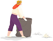 Girl volunteering collects garbage and rubbish on contaminated territory. Woman throwing paper waste