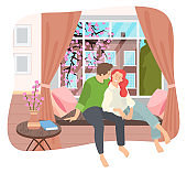 Couple sitting on windowsill at home in the room interior near big window with spring cityscape