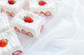 strawberry shortcake in plastic box on with cloth background and copy space, Minimal cake