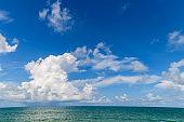 Beautiful white cloud and Blue Sky with sea at Mai Khao Beach Phuket,
