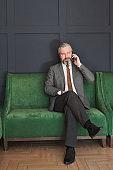 Mature businessman sitting on sofa