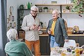 Senior men gathering together