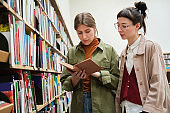 Young women in the library