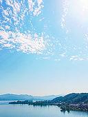 Idyllic Swiss landscape, view of lake Zurich in Wollerau, canton of Schwyz in Switzerland, Zurichsee, mountains, blue water, sky as summer nature and travel destination, ideal as scenic art print