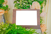 Wooden frame in table and flower stock