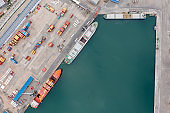 Aerial view of cargo ships in an International port.