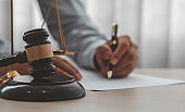 Male Judge working Document At Desk,Legal law, advice and justice concept.