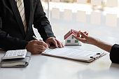 Real estate broker agent presenting and consult
