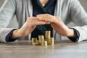 Woman hands protecting savings