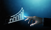 Business development to success and growing growth concept. Businessman pointing graph and arrow increase