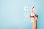 Hand choose to rating score happy icons. Customer service experience and business satisfaction survey concept