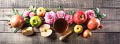 Rosh hashanah (jewish New Year holiday), Concept of traditional or religion symbols on old wooden background.