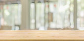 Empty wood table top with cafe restaurant window blur background