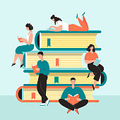 PrintPeople men women students read on a giant pile of books. Learning concept, love of reading. Library. Vector illustration in flat cartoon style