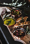 Pickled Greek olives, olive oil and herbed focaccia slices