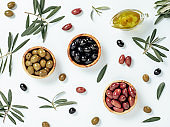 set of olives and olive oil on white background