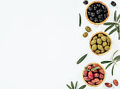 set of olives on white background, copy space