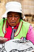 Portrait of Peruvian Woman on Uros Floating Island, Lake Tititcaca near Puno