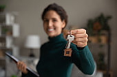 Close up of happy woman show keys to home