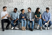 Confident motivated diverse job candidates and competitors making friends
