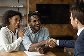 Happy biracial couple make agreement with realtor