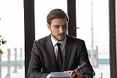 Caucasian businessman work with day planner in office