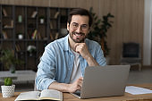 Portrait of happy young man work on laptop