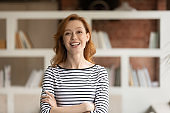 Portrait of smiling Caucasian businesswoman pose in office