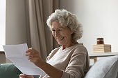 Happy elderly 60s excited about good news
