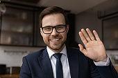 Headshot portrait of smiling businessman talk on video call