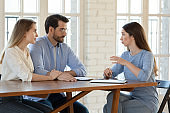 Female realtor consult couple about home purchase
