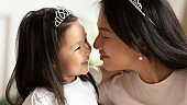 Close up Asian mother and little daughter enjoying tender moment