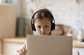 Smart small girl study on computer online
