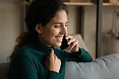 Smiling woman speak on cellphone with friend