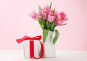 Pink tulip flowers bouquet and gift
