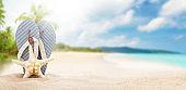 Flip flops on sunny sea beach with copy space