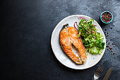 fresh salmon fried fish in a plate grilled seafood omega ready to eat on the table for healthy meal snack outdoor top view copy space food background rustic image pescetarian diet