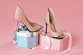 Pair of nude peep toe stiletto heels on gift boxes