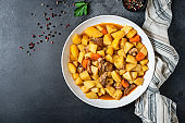 goulash meat with potatoes stewed vegetables and pork on the table for healthy meal snack outdoor top view copy space for text food background rustic image
