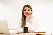 Smiling caucasian woman working on laptop