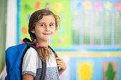 Portrait of school girl in classroom
