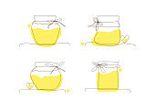 Set line art glass canning jars for honey, autumn and winter preservation. Preserved food, jars with yellow spots,hearts